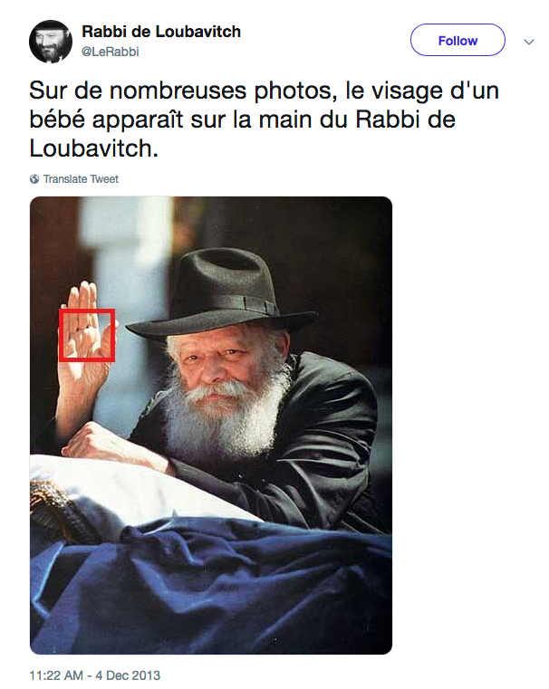 Photo du rabbi Loubavitch levant la main