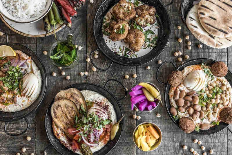 Photo représentant des assiettes de pita falafel du restaurant londonien Pita Jewpop