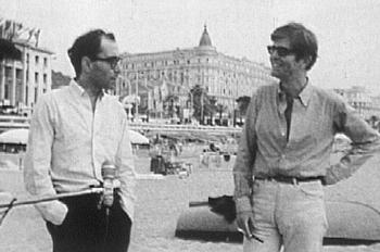 Photo représentant Jean-Luc Godard et Henry Chapier au festival de Cannes