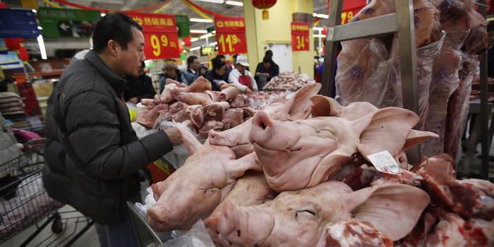 Photo représentant un étal de viande dans un marché en Chine Asie Jewpop