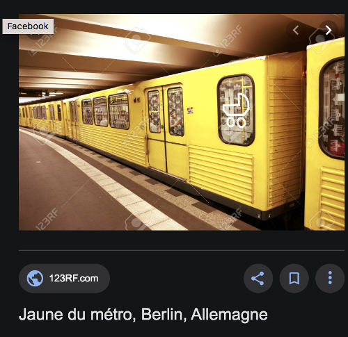 Photo d'un wagon de métro berlinois jaune Jewpop
